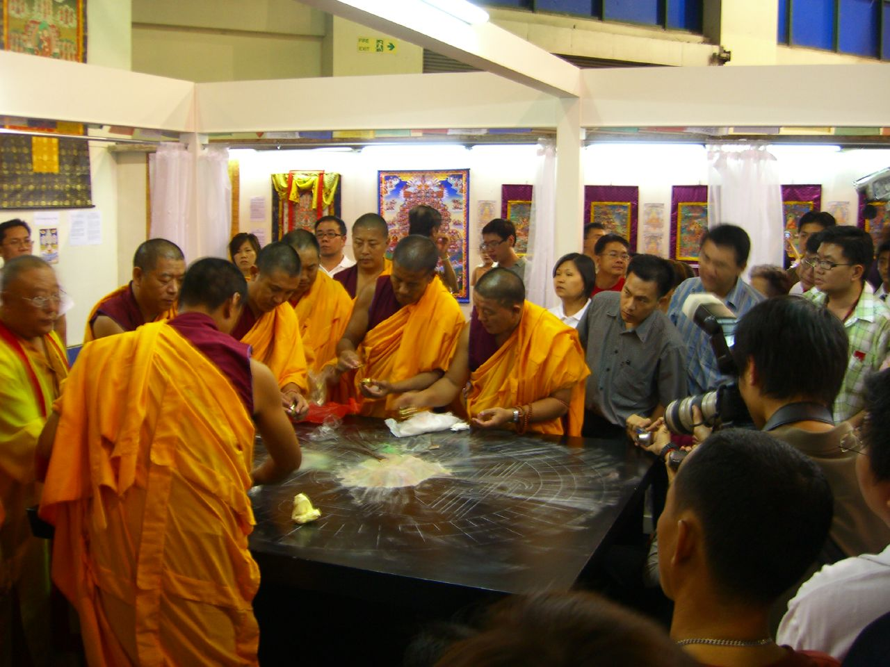 10th June - monks filling plastic bags with sands to be distributed