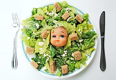 Caesar Sally (1) (boopsie.daisy) Tags: food silly cute green strange dinner lunch weird salad yummy crazy eyes doll pretty eyelashes peekaboo knife plate fork caesar dressing sally odd lettuce meal supper leafy quirky cutlery feta croutons dollhead kooky dollface caesarsalad fetacheese headoflettuce