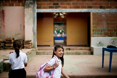 Students in a rural area of Colombia (World Bank Photo Collection) Tags: school girls latinamerica students smile look smiling rural walking education colombia exterior looking walk doorway worldbank schoolyard