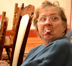 Oh, Granny (KellyZanotti) Tags: old blue grandma brown face tongue glasses chair nikon funny grandmother expression odd dslr wrinkles stickingouttongue d3100 nikond3100