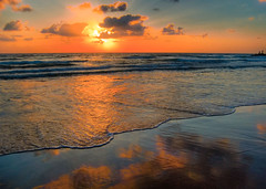 Evening Glow (NatashaP) Tags: light sunset sea sun seascape reflection beach night clouds israel sand nikon bravo waves grandmother dusk horizon explore thumbsup haifa soe breathtaking soothing interestingness2 naturesfinest thebigone bigmomma blueribbonwinner d40 supershot magicdonkey outstandingshots cy2 challengeyouwinner abigfave gickr superaplus aplusphoto ultimateshot superbmasterpiece beyondexcellence favemegroup4 diamondclassphotographer superhearts flickrelite theunforgetablepicture photofaceoffwinner photofaceoffplatinum platinumheartaward a3b thegoldenmermaid pfogold theroadtoheaven thegoldendreams exploreheaven poseidonsdance