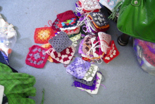 various granny squares on the floor