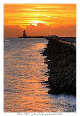 Early morning at the Great South Wall (HaukeSteinberg.com) Tags: morning ireland light dublin lighthouse water birds wall strand sunrise dawn coast early irland poolbeg irishsea dublinbay ire sigma70300 specnature 400d aplusphoto greatsouthwall diamondclassphotographer fineimage irlgallery