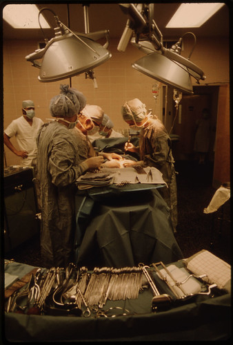 Dr. Howard Vogel, Third From Left, Is Assisted by His Daughter, Dr. Ann Vogel, as They Perform the Last Caesarean Section of a New-Born Child in Union Hospital in New Ulm, Minnesota...