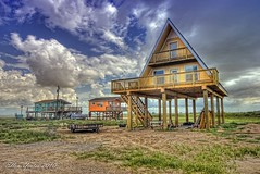 Triangle House (Ellen Yeates) Tags: wood blue sky cloud house galveston building beach canon austin weird ellen sand triangle texas freeport hdr surfside yeates trianglehouse