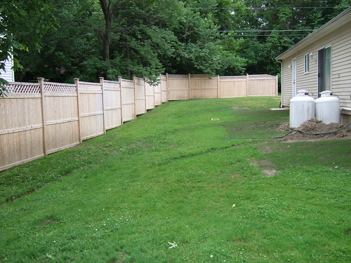 Landscaping Along New Cedar Privacy Fence
