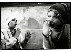 Slatina, Romania - 09/91 (tobydeveson) Tags: portrait 35mm blackwhite dragon vampire naturallight dracula communist communism devil fullframe transylvania gypsy uncropped kodaktmax400 gypsies draco rumania romanian drac orphanages roumanie nikomat nikkormat wearinghats moldavia scannedprint roumania countdracula ceaucescu easterneuropean eatingfood bramstoker vladtheimpaler rundownbuildings ottomanempire romnia rumanian darkroomprint wallachia vladdracul romn drakulya kazklvoyvoda elenapetrescu orderofthedragon sonofthedragon princeofwallachia vladepe vladiiitheimpaler drculea nicolaeceauescu impalerprince vladiii romanianorphans  postceaucescu primefixed24mmlens rumn eararumneasc voivodeofwallachia wladislausdragwlya drakwlya youngboysstaringintocamera