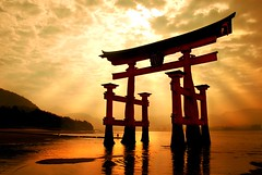 the gateway (Dan65) Tags: sea sky cloud sun water japan bravo gate shrine day cloudy 5 tide miyajima explore gateway  rays kitschy shinto inland torii itsukushima  blueribbonwin