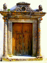 Rustic Door (Sandra_R) Tags: door wood old brown portugal stone architecture outdoors photography colours exterior decay details rustic nobody typical ornate alentejo marvo portalegre castelodevide abigfave flickrdiamond ruinsruralscenes