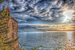 Chillon Castle and Lake of Geneva (Available for licensing and purchase) (! .  Angela Lobefaro . !) Tags: old trip travel italien vacation sky italy panorama lake nature topf25 topv111 architecture clouds landscape schweiz switzerland interestingness firefox topf50 topv333 suisse alt quality patterns topv444 dream gimp himmel wolken topv222 bleu explore ciel nubes linux chillon svizzera nuages schloss ubuntu idyllic castillo allrightsreserved coucherdesoleil italians 2007 outstanding montreux sogno traum kubuntu laclman chteaudechillon chilloncastle digikam hoky x500 i500 cesvi bestphotosonflickr bestpicturesonflickr anawesomeshot qtpfsgui holidaysvacanzeurlaub angiereal superhearts theunforgettablepictures noqualitynocry maxgreco angelalobefaro angelamlobefaro wwwcesviorg angelamarialobefaro massimilianogreco
