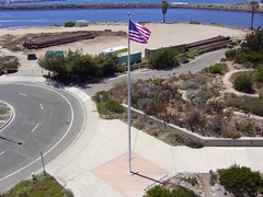 Channel Island National Park visitors center flag pole with flag (flyingcamera) Tags: california above park fish kite beach water america photography nationalpark surf waves cam aerial american sail kap aerialphotography ventura channel hobie kiteaerialphotography flowform channelisland americ channelislandnationalpark kiteview