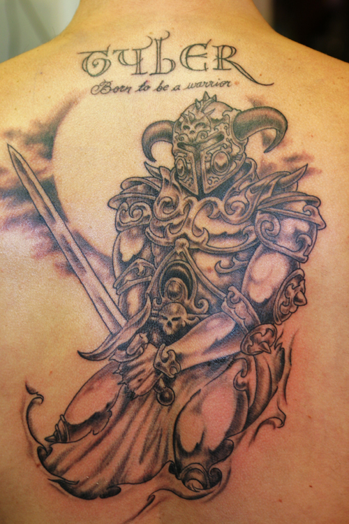 Grey Warrior Tattoo at the back. [Image Credit: thetattoostudio]