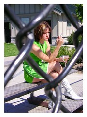Through the Fence (summitave) Tags: cigarette martini redhead greendress cigarettesmoke