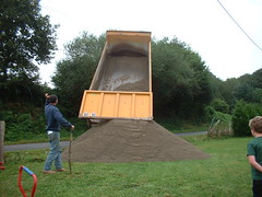 'Small' lorry delivering sand