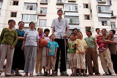 3/6 standing tall. (theshanghaieye) Tags: street portrait building cane happy support looking apartment pavement crowd chinese posing guinness walkingstick portraiture stick tall curious apartmentcomplex neighbors neighbor shanghaiist height elmundo towering tallest mongolian worldrecord innermongolia guinnessworldrecord recordholder  chifeng worldstallestman xishun baoxishun 2361cm 7ft895in