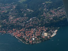 Lago di Como - Menaggio (_ Night Flier _) Tags: above city travel blue sky italy panorama lake green rooftop nature water airplane landscape town flying high view earth top aviation aerial h2o fromabove coastline lombardia cessna skyview lagodicomo lombardy birdeye aeronautic menaggio