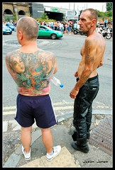 Tattooed men (jjay69) Tags: green car leather tattoo ink cafe ace trousers shorts shavedhead chav streetfighter leathertrousers backtattoo largebacktattoo