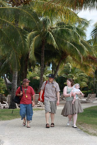 Sauntering along beside the pool. Spot the tourist!