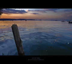 High Tide (Kevin English Photography) Tags: ocean travel blue sunset summer sky orange usa beach water clouds photoshop landscape island bay boat washington high nikon pacific northwest tide smooth thunderstorm camano windless d1h nikond1h utsalady kevinenglish ambientfocus