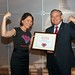 MomsRising Healthcare Director Donna Norton presenting a Superhero Award to Sen. Menendez