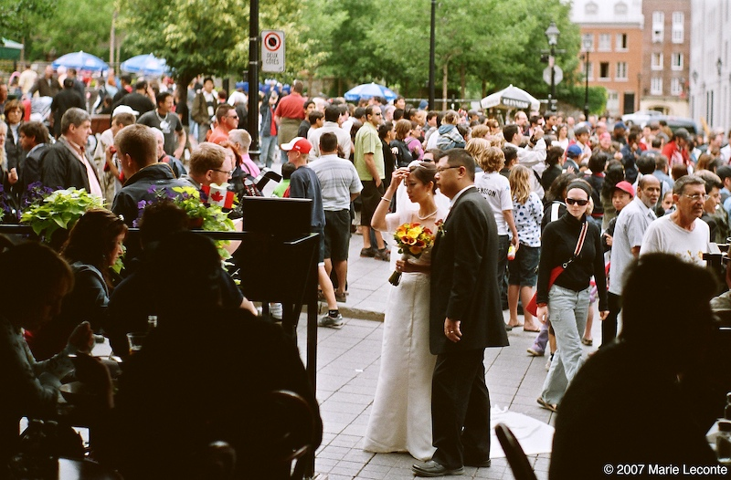 Bride and groom in a crowd