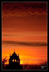 Sunset over Holloway College (MarkLandonPhotography) Tags: sunset red orange colour tower clock silhouette yellow clouds bright vibrant minaret duotoned egham englefieldgreen royalholloway marklandonphotography