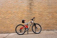 someone got a new bike (xgray) Tags: red black brick bike bicycle wall digital upload 35mm canon silver austin eos prime university texas lock bricks universityoftexas iphoto schwinn bikerack hitchingpost ef35mmf2 40d jestercenter