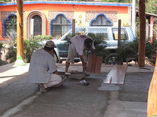 Laying the tiles in the palapa