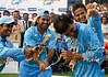 India s Karthik Dhoni and Pathan pours soft drinks on Ganguly after he was announced as man of the series in Visakhapatnam