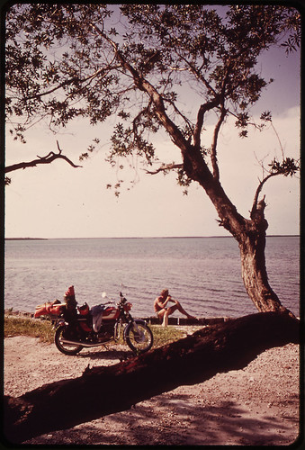 Vacationer From Ohio Relaxes near His Motorcycle During Sightseeing Tour of the Keys.