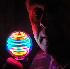 Self-Portrait with Light Spinner (ricko) Tags: selfportrait face toy coloredlights 1on1colorfulphotooftheweek 1on1colorfulphotooftheweekjuly2007 lightspinner