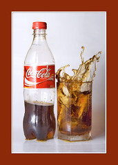 Let's have some fun with Coke before we drink it :) (AHMED...) Tags: pakistan red stilllife color water glass closeup canon catchycolors 350d rebel xt interestingness waterdrop colorful stream action sweet framed border coke explore delicious pakistani soda rebelxt splash karachi ahmed sind catchy soe sindh sparkling highspeed muhammad waterstream splashing 28105mm bouncedflash fruitsplash i500 mehrabpur muhammadahmed