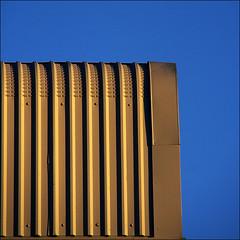 Enclosure (ScudMonkey) Tags: blue sky urban abstract colour lines contrast canon 350d shadows minimal squareformat yelow tamron bold ridged stocktonontees artitecture xrdiii18200 paulbradley