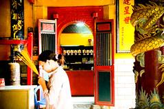 Praying (Huey Yoong) Tags: portrait girl lady asian religious temple asia chinatown traditional praying chinese vietnam saigon hochiminhcity josssticks environmentalportrait southvietnam 5photosaday nikkor18200mmvr nikond300