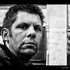 Ruubface (Pjotre7 (www.maartenvandevoort.nl)) Tags: light portrait bw italy sun white abstract black milan holland art netherlands beautiful dutch face contrast photo blackwhite model focus funny mood foto tour dof artistic expression milano sony milaan story nik emotions gaze tilburg dsc blik bold 2010 topaz boos stoer frons baseballtrips hx1 sonyhx1 pjotre7 piposconpasta ruubface