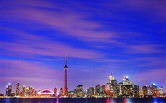 The Blue Hour on Toronto, with a touch of pink (David Giral | davidgiralphoto.com) Tags: longexposure pink blue sky urban chien toronto ontario canada david reflection tower skyline night skyscraper cn landscape evening nikon bravo long exposure cityscape cntower skyscrapers purple shot dusk windy hour royalyork highrise entre loup bluehour d200 et fairmont heure giral rogerscenter magique nikond200 supershot vle 18200mmf3556gvr entrechienetloup copyrightdgiral davidgiral bestofr
