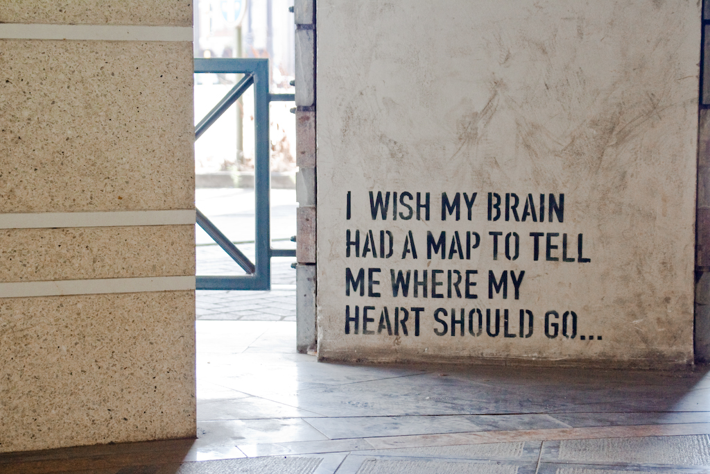 stencilled graffiti on concrete: I wish my brain had a map to tell me where my heart should go...