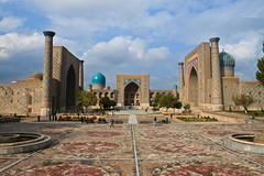 Uzbekistan-111 (Kelly Cheng) Tags: travel school color colour building heritage tourism horizontal architecture square daylight colorful asia cloudy outdoor mosaic madrasah muslim islam religion lion culture sunny unesco dome getty silkroad portal colourful copyspace uzbekistan centralasia samarkand madrassa registan islamic samarqand silkroute medressa ulugbek sherdor ulughbeg tillakari gettysale 92781751 pickbykc gi0912 gi1210 gi1203 gi1207