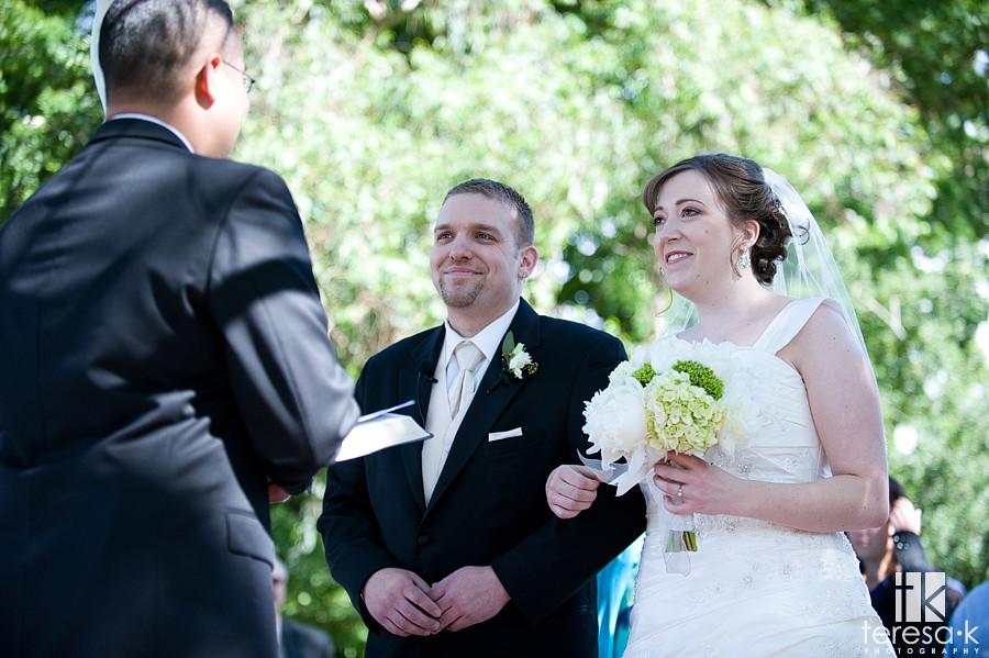 Christian outdoor wedding ceremony at vineyard