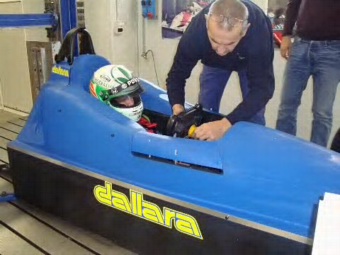 EJ Viso at Dallara doing a seat fitting for the new 2012 Indycar