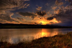Sunset (Thad Roan - Bridgepix) Tags: statepark blue sunset orange sun sunlight foothills lake storm mountains color reflection water grass yellow clouds skyscape landscape scenery colorado colorful denver reservoir chatfield hdr littleton naturesfinest blueribbonwinner photomatix specland 200706 abigfave anawesomeshot colorphotoaward ultimateshot beyondexcellence sperbmasterpiece bestsun