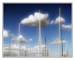 Floating Softly (robert_goulet) Tags: blue sky ontario canada blur clouds burlington boats olympus mast lakeontario zuiko orton gaussian evolt sailbot e500 zd fourthirds