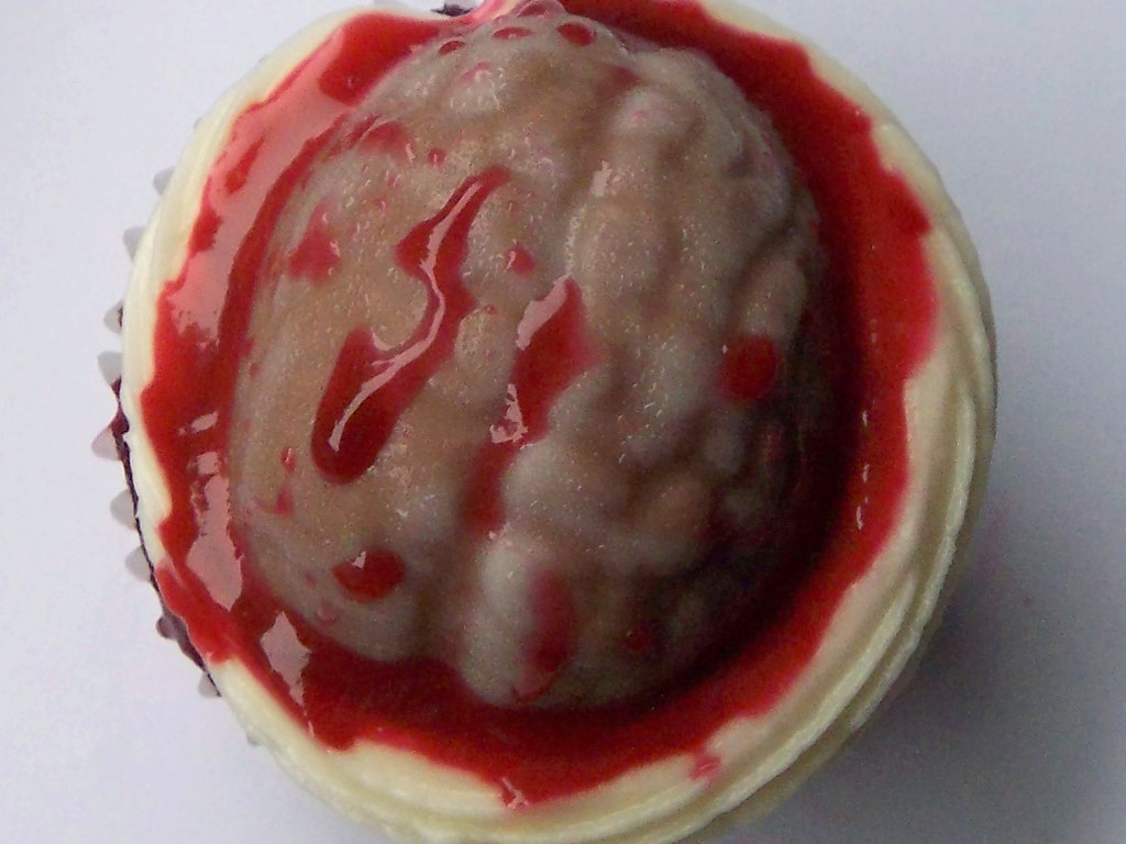 Red velvet raspberry cake with French vanillla cream cheese frosting and a chocolate brain  by Pamela