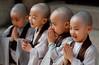 In their Expressions (Derekwin) Tags: seoul korea korean monk buddhism buddha lotuslanternfestival lotus festival panasonic panasonicgf1 canon50mmf14fd canon 50mm fd f14 gf1 m43 little monks shaved robes smile happy pray praying grey brown jogeysa temple buddhasbirthday child children jogyesa panasonicdmcgf1 lumix panasoniclumixdmcgf1 topf200 topf250