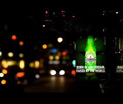 Heineken x Bokeh (zyork_) Tags: world street city nightphotography bus beer amsterdam by night vancouver canon advertising heineken rebel born marketing colorful downtown bokeh streetlights busstop advertisement stop alcohol whore raised downtownvancouver project365 1000d bokehliciousbokeh bokehphotography xscanon heinekenxbokeh