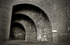 Arches (tootdood) Tags: blackandwhite sepia geotagged manchester bravo canon20d curves arches toned castlefields geo:lat=53475222 geo:lon=2254869 thinkcam