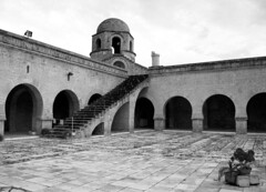 Sousse's Mosque Courtyard (Donna Corless) Tags: africa travel blackandwhite bw white black architecture tunisia courtyard mosque sousse donnacorless
