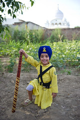 Here's wishing you the smiles o' life and not a single grumble (gurbir singh brar) Tags: fatehdivas fatehgarhsahib 2010 punjab sirhind boy child happy smile smiling cheerful confident martial khalsa sikh punjabi fatehsingh gurbirsinghbrar chardikala character personality handsome dumala turban yellowdress chola bana          2470mmf28g nikkor nikon nikond3s gurdwarajyotisarup bat baseball firstbase diamondclassphotographer flickrdiamond
