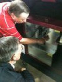 Rush Holt inspects voting machine (1 of 3)