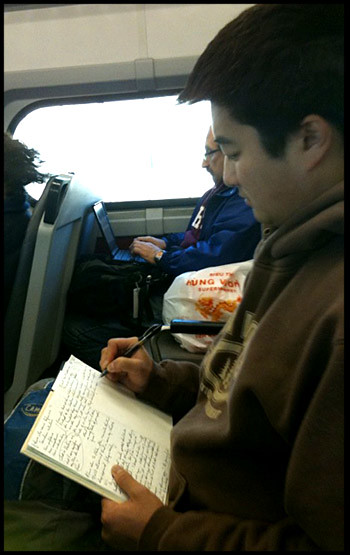 train-man-writing